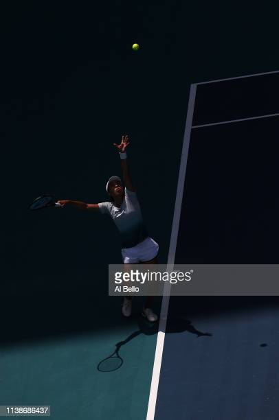 Qiang Wang of China serves against Simona Halep of Romania during day 10 of the Miami Open presented by Itau at Hard Rock Stadium on March 27 2019 in...