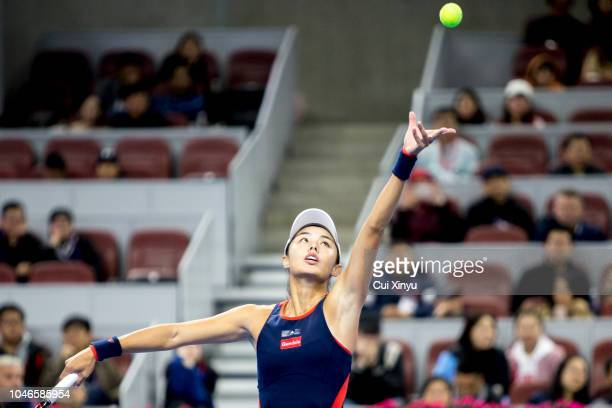 Qiang Wang of China serves to Caroline Wozniacki of Denmark during her Women's Singles Semifinals match in the 2018 China Open at the China National...