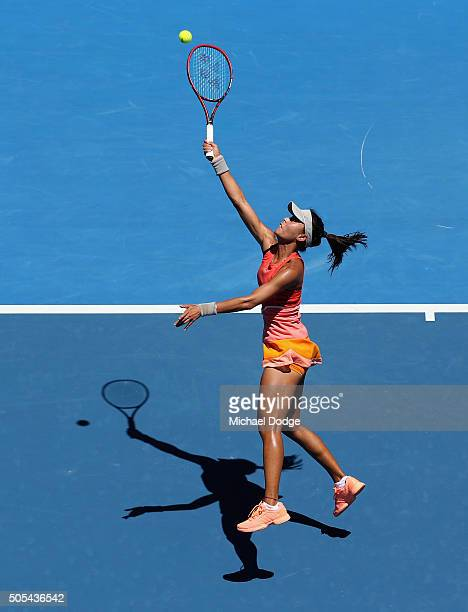 Qiang Wang of China smahes a lob shot in her first round match against Sloane Stephens of the United States during day one of the 2016 Australian...