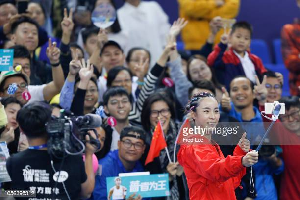 Qiang Wang of China takes a selfie with fans after she defeated Madison Keys of the United States during their group stage women's singles match on...