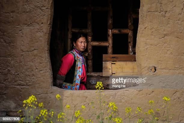 A Qiang woman poses at the Qiang King Mansion on March 28 2018 in Wenchuan County Radish village Ngawa Tibetan and Qiang Autonomous Prefecture...