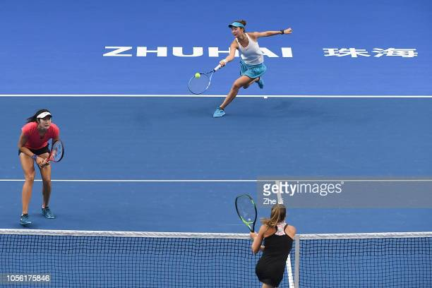 Qianhui Tang of China and Fang Ying Xun of China return a shot against Mihaela Buzarnescu of Romania and Alicja Rosolska of Poland during their...