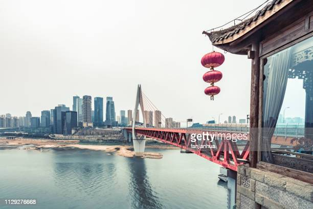 qianximen bridge with chongqing skyline against sky - yangtze river stock pictures, royalty-free photos & images