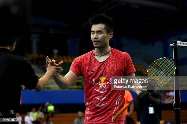 Qiao Bin of China celebrates victory after beating Anthony Sinisuka Ginting of Indonesia during Men's Team Final match between Indonesia and China in...