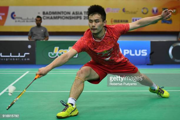 Qiao Bin of China competes against Anthony Sinisuka Ginting of Indonesia during Men's Team Final match between Indonesia and China in the EPlus...