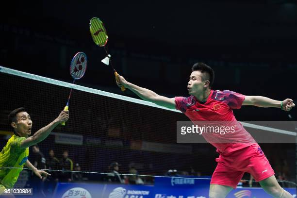 Qiao Bin of China hits a return against Lee Chong Wei of Malaysia during their men's singles first round match at the 2018 Badminton Asia...
