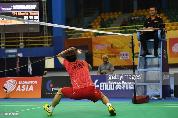 Qiao Bin of China throws his racket accross the court after beating Anthony Sinisuka Ginting of Indonesia during Men's Team Final match between...