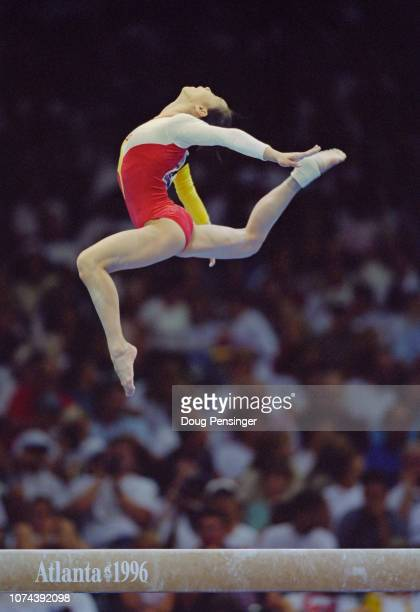 Qiao Ya of China competing in the Balance Beam event of the Women's artistic team allaround competition during the XXVI Summer Olympic Games on 23...