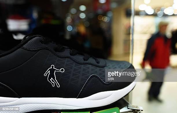 Qiaodan brand shoe is displayed at a Qiaodan store in Hangzhou in China's Zhejiang province on December 8, 2016. Basketball mega-star Michael Jordan...