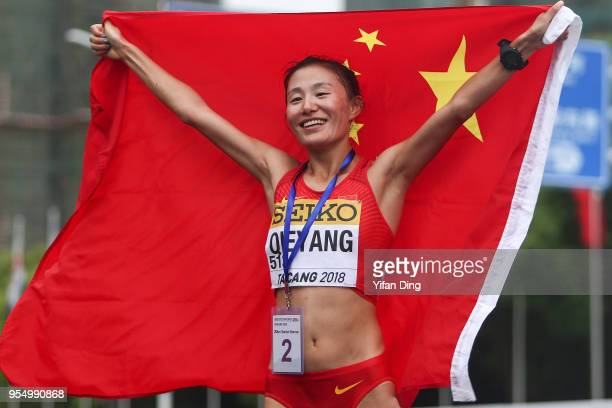 Qieyang Shijie of China celebrates after she wins silver medal of the Women's 20 kilometres Race Walk of IAAF World Race Walking Team Championships...
