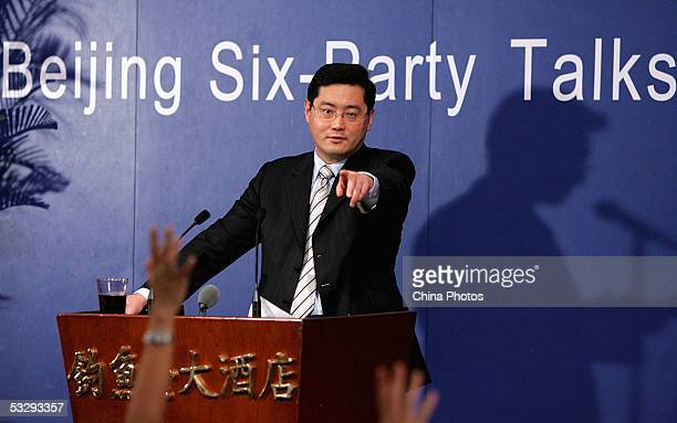 Qin Gang spokesman of the Chinese delegation listens to a question at a press conference of the Sixparty Talks on July 26 2005 in Beijing China...