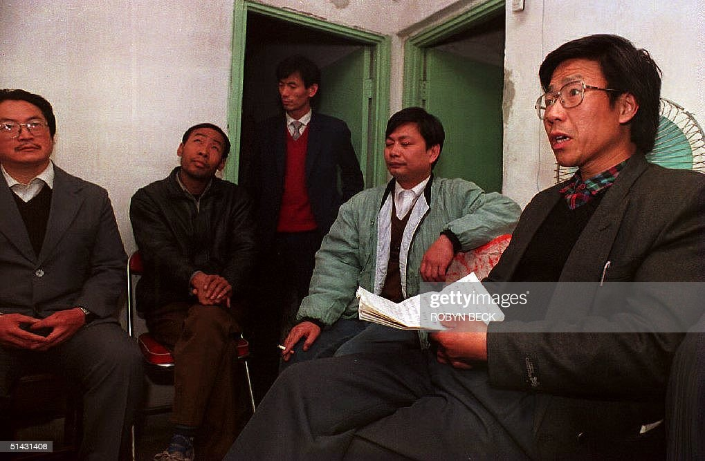 Qin Yongmin (R) meets with fellow pro-democracy activists in a Beijing apartment to announce the formation 14 Novembeer 1993 of a 'Peace Charter' group, calling on the Communist Party to accept a multi-party system. Charter signers are from