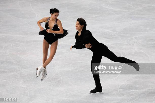 Qing Pang and Jian Tong of China perform in the Paris Short Program during day one of Trophee Eric Bompard ISU Grand Prix of Figure Skating 2013/2014...