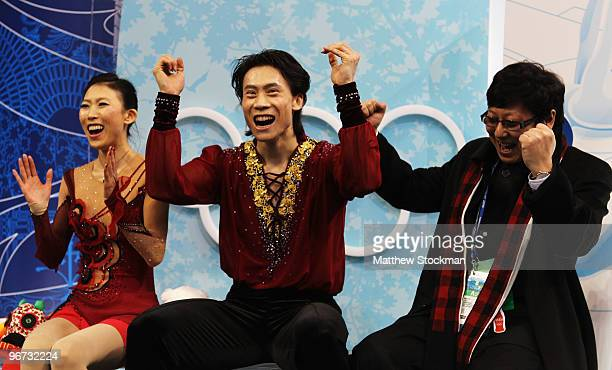 Qing Pang and Jian Tong of China reacts in the kiss and cry area after they competed in the figure skating pairs free skating on day 4 of the...