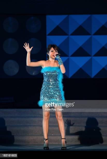 Qing Xi of China sings at the 13th Global Chinese Music Awards at Putra Stadium on October 5 2013 in Kuala Lumpur Malaysia