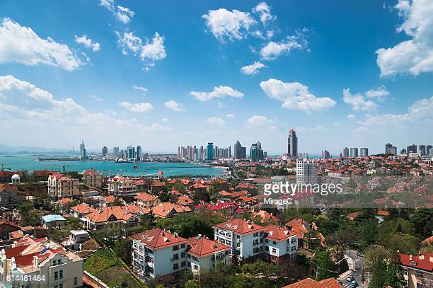 qingdao bay cityscape - qingdao beach stock pictures, royalty-free photos & images