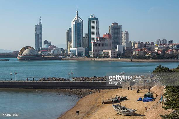 qingdao bay with skyscrapers in back - miragec stock pictures, royalty-free photos & images