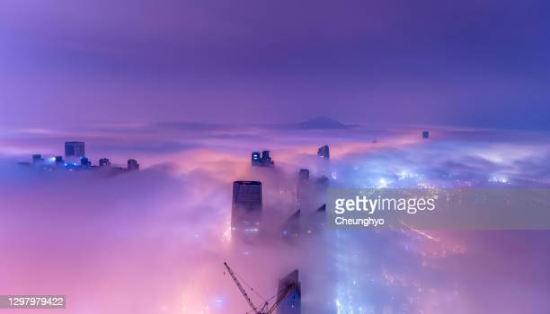 qingdao city in the mist at night - cloudscape stock pictures, royalty-free photos & images