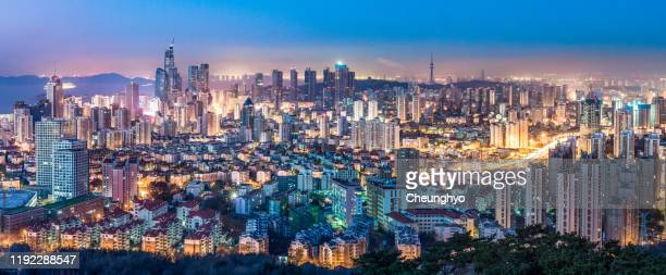 qingdao city skyline at dawn - qingdao beach stock pictures, royalty-free photos & images
