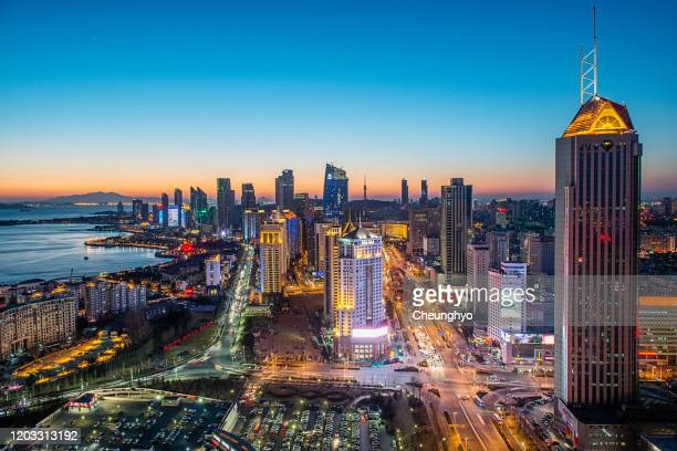 qingdao city skyline at night - qingdao beach stock pictures, royalty-free photos & images