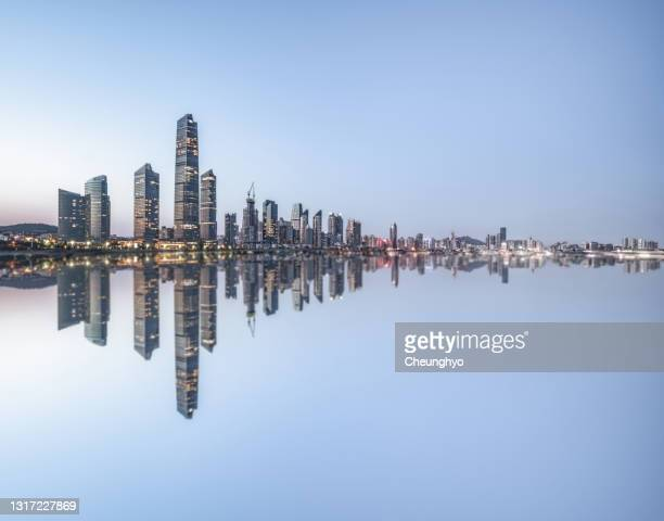 qingdao city skyline - qingdao stock pictures, royalty-free photos & images