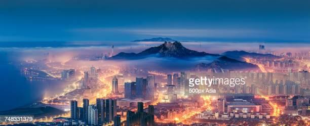 Qingdao city with mountain at night, Shandong, China