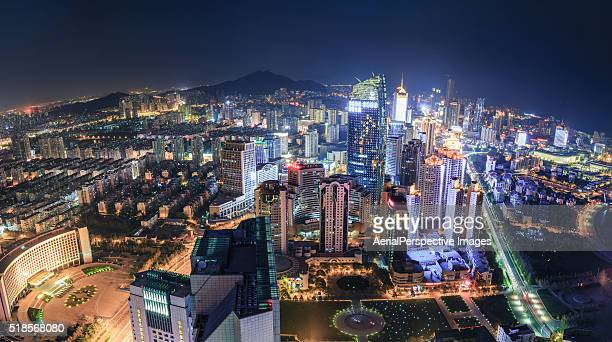 qingdao cityscape panorama at night - qingdao beach stock pictures, royalty-free photos & images