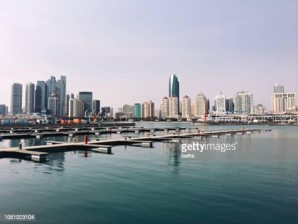 Qingdao Olympic Sailing Center & International Marina against the city skyline.