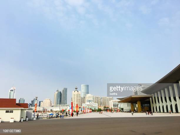 Qingdao Olympic Sailing Center & International Marina against the city skyline.