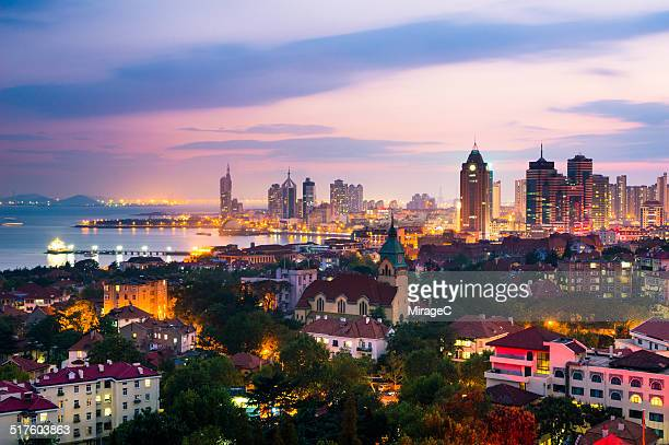 qingdao seashore night scene on signal hill - qingdao beach stock pictures, royalty-free photos & images