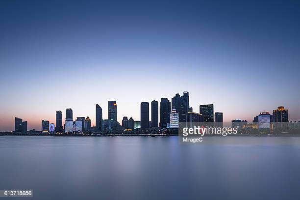 qingdao skyline illuminated - miragec stock pictures, royalty-free photos & images