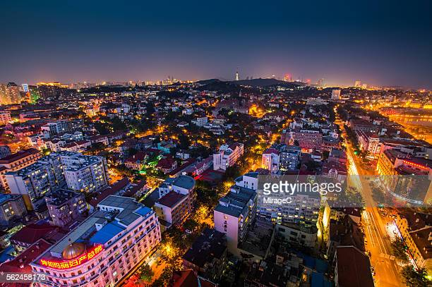 qingdao west city night view - miragec stock pictures, royalty-free photos & images