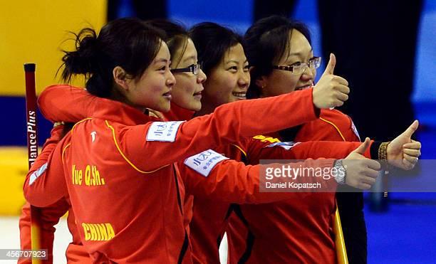 Qingshuang Yue of China and team mates Bingyu Wang Yin Liu and Yan Zhou celebrate after the Olympic Qualification Tournament playoff match between...