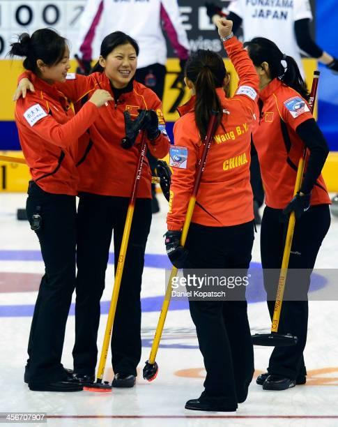 Qingshuang Yue of China and team mates Yin Liu Bingyu Wang and Yan Zhou celebrate after the Olympic Qualification Tournament playoff match between...