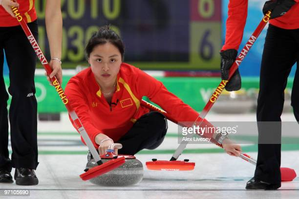 Qingshuang Yue of China releases the stone during the women's bronze medal curling game between China and Switzerland on day 15 of the Vancouver 2010...