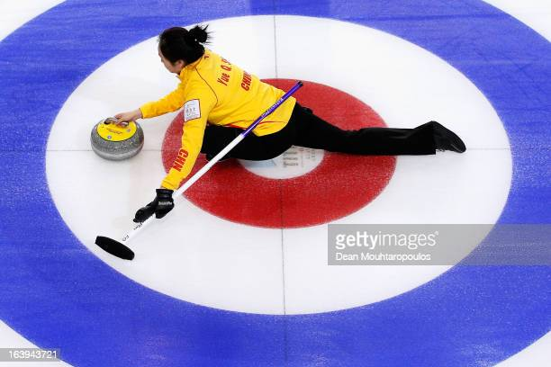 Qingshuang Yue of China releases the stone in the match between China and Italy during Day 3 of the Titlis Glacier Mountain World Women's Curling...
