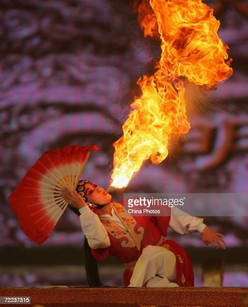 Qinqiang Opera artists perform fire breathing during the '2006 Pageant Xian' on October 21 2006 in Xian of Shaanxi Province China The pageant was...