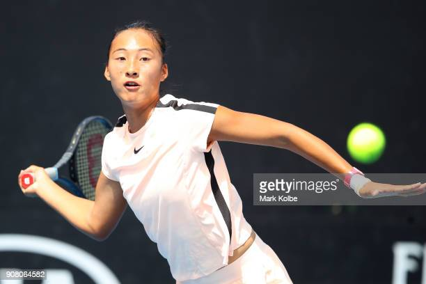 Qinwen Zheng of China plays a forehand against Amber Marshall of Australia during the Australian Open 2018 Junior Championships at Melbourne Park on...