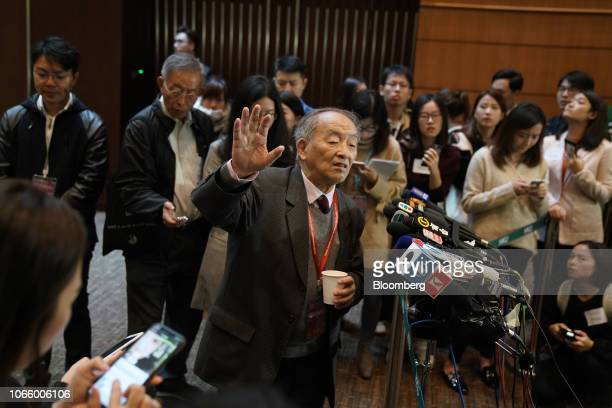 Qiu Renzong professor at the Chinese Academy of Social Sciences speaks to members of the media at the Second International Summit on Human Genome...