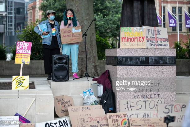 Qiu Yan and Jamie , a member of Queer China UK, speaks outside Parliament Square during the Stop Asian Hate rally in London. Demonstrators held a...