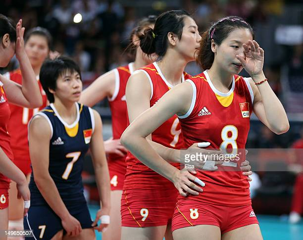 Qiuyue Wei Junjing Yang and Xian Zhang of China react after losing to the United States during Women's Volleyball on Day 5 of the London 2012 Olympic...
