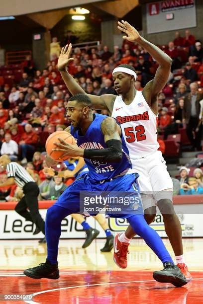 Qiydar Davis guard Indiana State Sycamores rebounds the basketabll in front of Milik Yarbrough forward Illinois State University Redbirds Sunday...