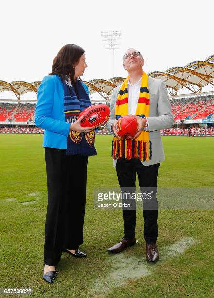 Qld premier Anastasia Paluszek chats with SA Premier Jay Weatherill during the AFL Women's Grand Final between the Brisbane Lions and the Adelaide...