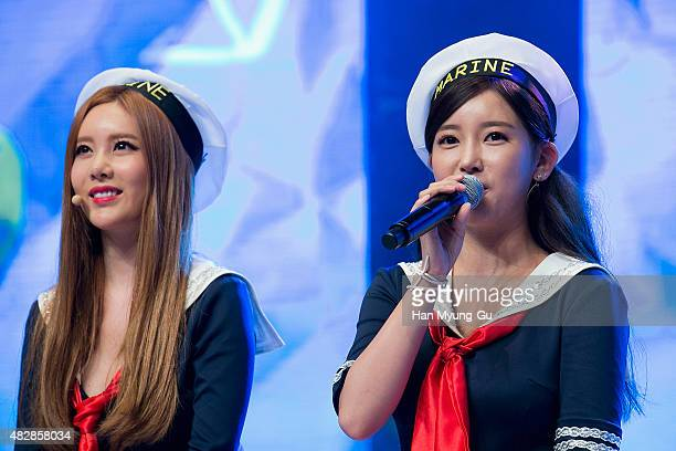 Qri and Soyeon of South Korean girl group Tara attend the press showcase for their 11th Mini Album 'So Good' on August 3 2015 in Seoul South Korea