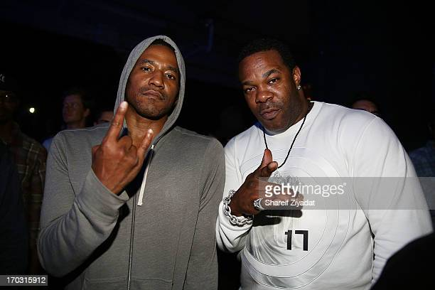Tip and Busta Rhymes attend the Kanye West album listening party at Milk Studios on June 10 2013 in New York City