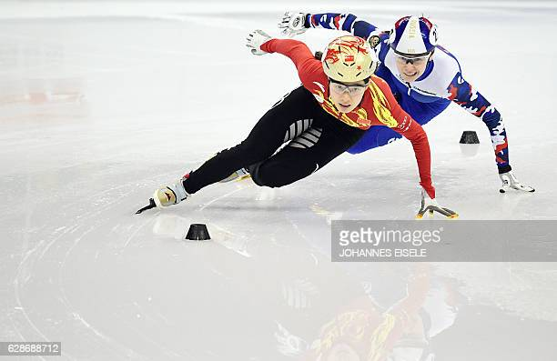 TOPSHOT Qu Chunyu of China competes ahead of Emina Malegich of Russia during the women's 500m qualifying at the ISU World Cup Short Track speed...