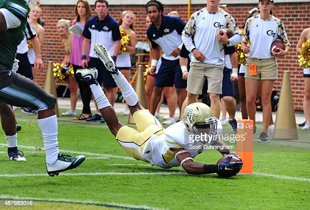 Qua Searcy of the Georgia Tech Yellow Jackets dives across the goal line for a first quarter 13 yard touchdown against the Tulane Green Wave on...