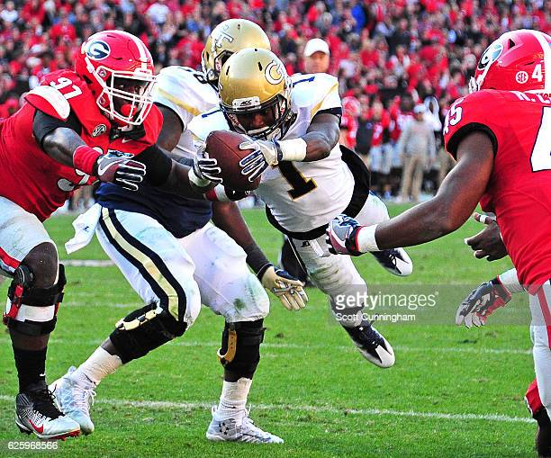 Qua Searcy of the Georgia Tech Yellow Jackets dives across the goal line for the game winning touchdown against the Georgia Bulldogs at Sanford...