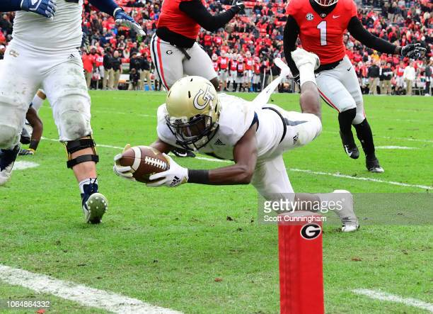 Qua Searcy of the Georgia Tech Yellow Jackets dives in for a fourth quarter touchdown against the Georgia Bulldogs on November 24 2018 at Sanford...