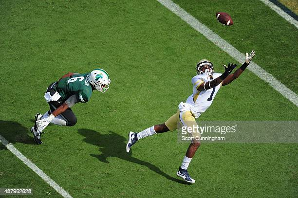 Qua Searcy of the Georgia Tech Yellow Jackets goes up for a pass against Jarrod Franklin of the Tulane Green Wave on September 12 2015 at Bobby Dodd...